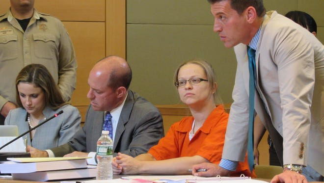 Angelika Graswald, center, sits in Orange County Court Tuesday with lawyer Richard Portale on the right, co-counsel Jeffrey Chartier on the left  and and associate Kimberly Pelesz on the far left.