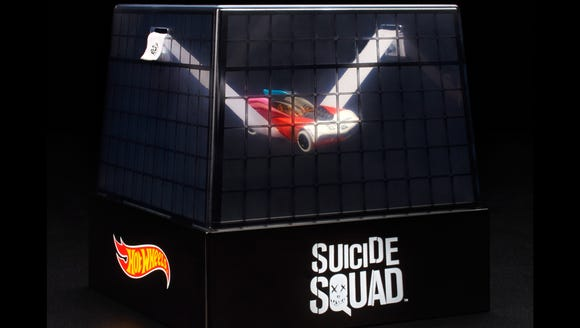 A Harley Quinn Hot Wheels car has her in a suspended