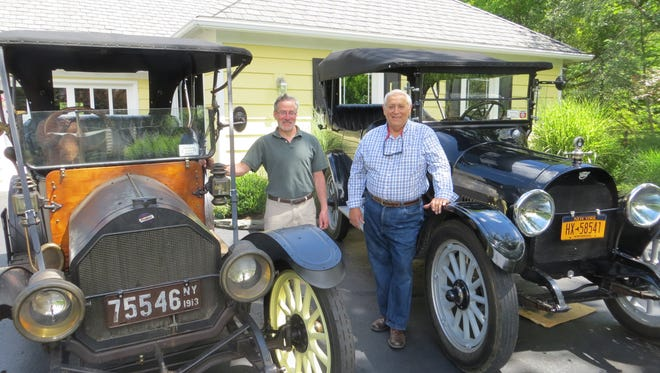 Randy Marcus, left, next to his 1913 Willys-Overland and Tom Overbaugh with his 1915 REO, are hosting a week-long classic car tour of the Finger Lakes which will include 90 participants and 38 antique automobiles.