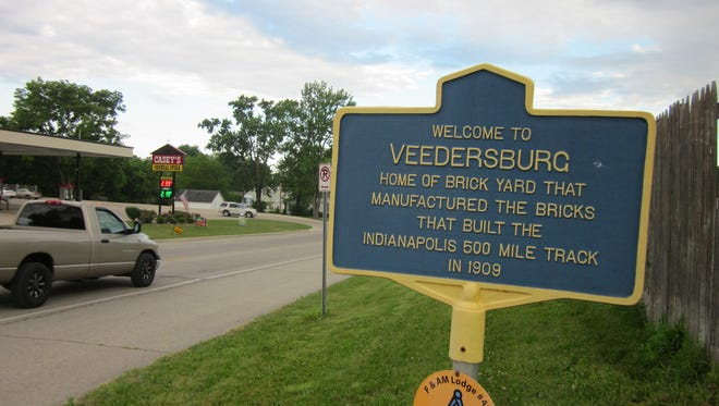 """This historic marker, noting Veedersburg's  tie to the creation of """"The Brickyard""""  at the Indianapolis Motor Speedway,  was installed several years  ago. Most of the 3.2 million bricks used to pave the track in 1909 were """"Culver Block"""" pavers from the Wabash Clay Company brickyard south of town."""
