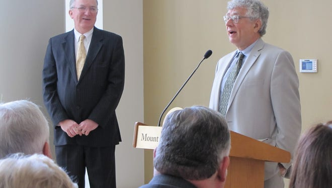 Mount Saint Mary College Board of Trustees Chairman Charles Frank, left, looks on as David A. Kennett, interim president of Mount Saint Mary College, introduces himself to members of the college community Monday.