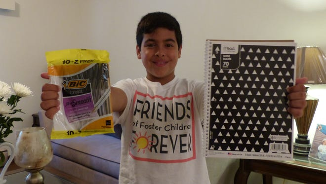 Leonardo Iriarte, 10, shows off just some of the school supplies that he's collected in recent weeks. He collects school supplies and toys from people in the community, and turns them in to Friends of Foster Children Forever in Naples.