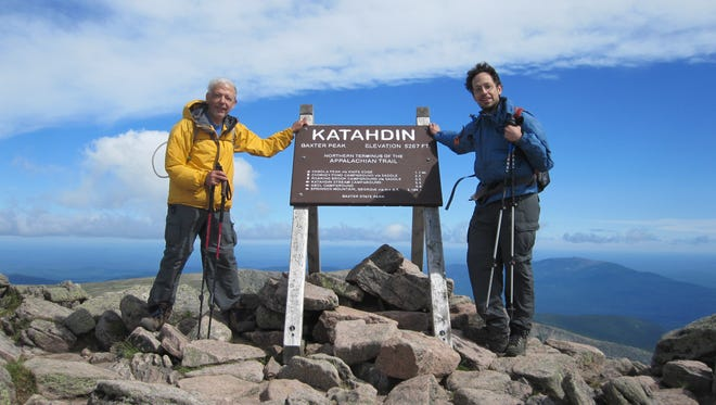 Doctors John and Steven Eliades pose for a picture on Mount Katahdin in Maine, their last stop on their 21-year trek of the Appalachian Trail. Both of them are Eagle Scouts.