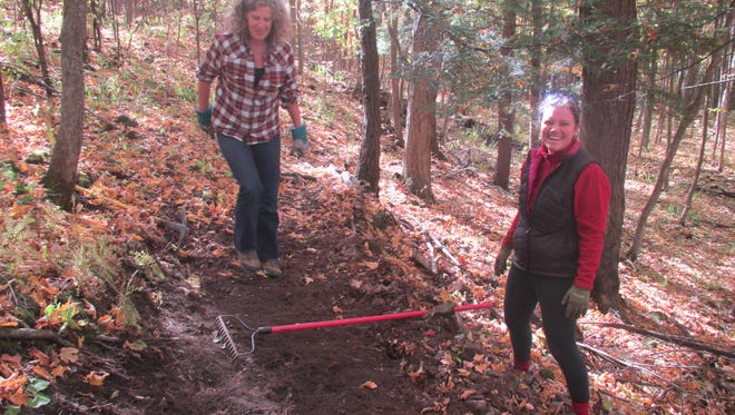 Shelburne residents, Elizabeth Campbell and Tarn Foerg take a turn at trail building on Saturday Oct. 15, 2016.