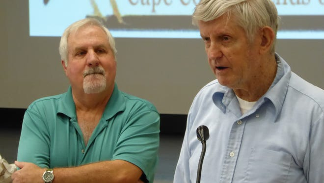 Environlemtal leader and Audubon of SW Florida President Dan Van Norman, left, presented Carl Veax with the Conservationist of the Year award.