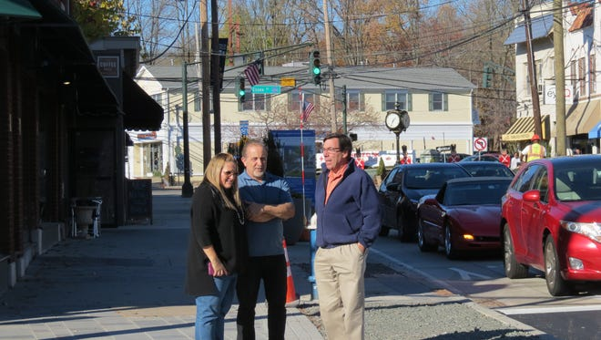 From left, Downtown Millburn business owners Vicky Powell, Gennaro Raimo and Harry Roth check out the progress of the Complete Streets project.