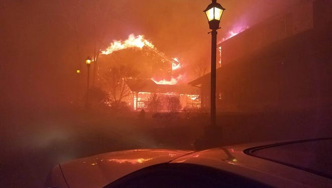 A handout photo made available on November 29, 2016 by the Arrowmont School of Arts and Crafts showing a school building on fire during evacuation as wildfires move through the area, in Gatlinburg, Tennessee, USA, 28 November 2016. Reports state that three people have died because of the wildfires, and hundreds of buildings have been destroyed. Thousands of residents have been evacuated.  EPA/BILL MAY / ARROWMONT SCHOOL OF ARTS AND CRAFTS / HANDOUT  HANDOUT, EDITORIAL USE ONLY, NO SALES