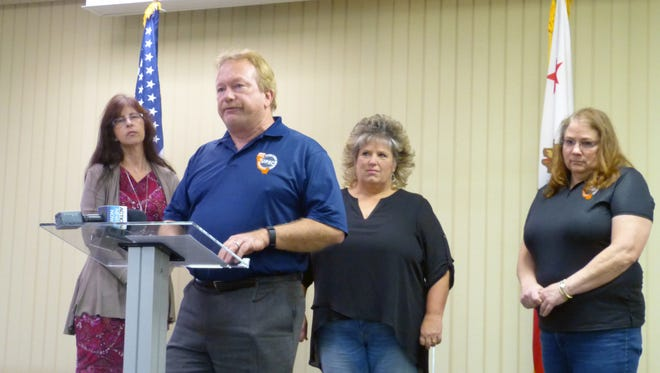Chris Darker, center left, a business manager with the United Public Employees of California Local 792 union, speaks Friday during a press conference about ongoing contract disputes with Shasta County. Also pictured, from left: Shasta County employees Maureen Robison, Karen Steppat and Twyla Carpenter