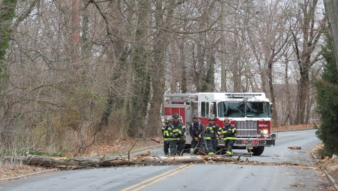 Millburn firefighters arrive on Glen Avenue Jan. 23 to remove a tree that toppled into the roadway during the day's nor'easter.