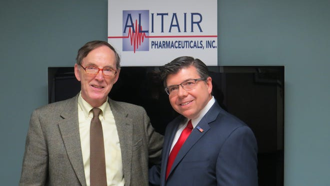 Dr. William Howard, left, with Assemblyman Anthony M. Bucco, in the offices of Haward's company, Alitair Paharmaceuticals, in Morristown.