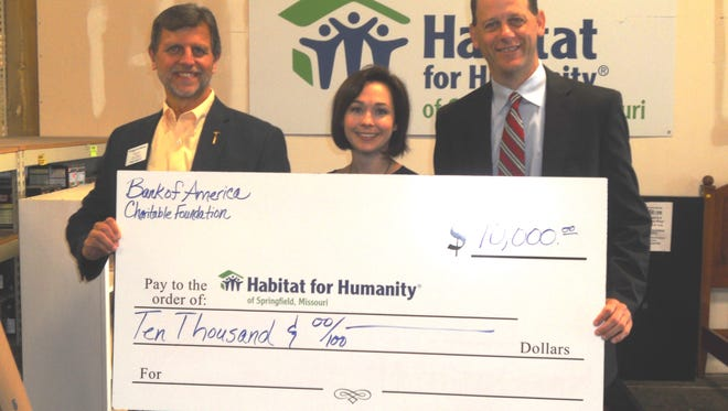 Mike Pinkston from Bank of America poses with HFHS Staff Members with $10,000 check for a home rehab. The project these funds will support is estimated to be complete by December 2017. Pictured from left to right: Larry Peterson, executive director of HFHS, Brandi VanAntwerp, development director of HFHS, Michael Pinkston, financial advisor with Merrill Lynch.