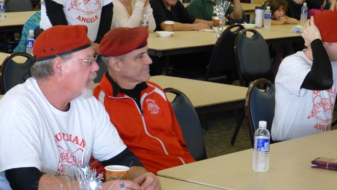 Guardian Angels founder Curtis Sliwa, center, listens Saturday during the Stomp the Bully Seminar at Redding Rancheria.