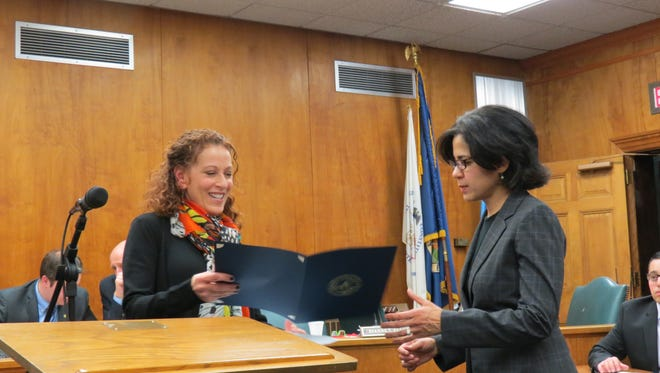 Committeewoman Dianne Eglow, left, presents a proclamation to Julie London of Opportunity Project at the Feb. 21 Millburn Township Committee meeting. The proclamation recognized March as Brain Injury Awareness Month.