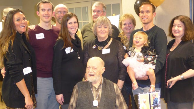 Family and friends gathered Saturday at Covenant Church in West Lafayette to celebrate the 100th birthday of former Purdue faculty member and Mackey Arena usher Bill Fall, front.