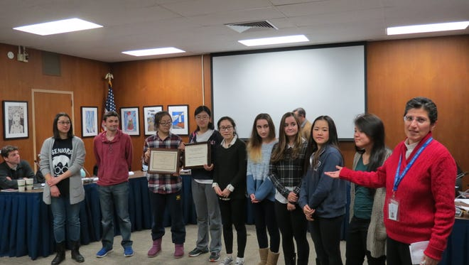 English teacher and advisor Minaz Jooma, right, introduces the staff of the Millburn High School literary magazine, Word, which was recently honored with several national awards for excellence.