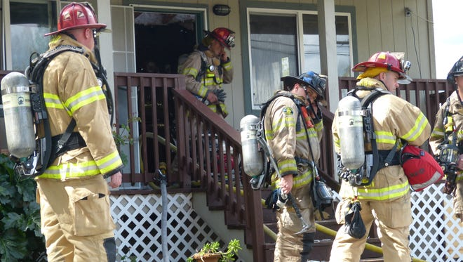 Redding firefighters quickly knock down a fire that broke out Tuesday inside an Olive Street home.