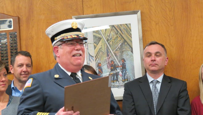 Retiring Fire Chief Michael Roberts addresses the audience at the March 21 Township Committee meeting.