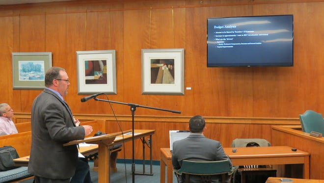 Millburn Chief Financial Officer Jason Gabloff presents the proposed 2017 municipal budget at the April 18 Township Committee meeting.