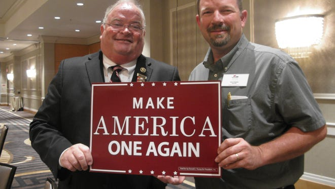 Rep. Billy Long shows his support for Trump at the Republican National Convention with Missouri delegate.