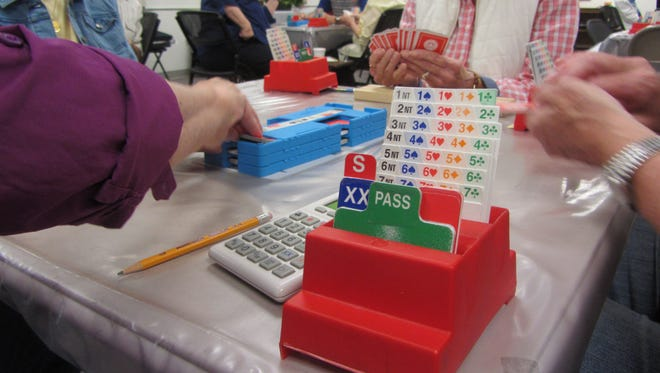 Duplicate bridge requires players to play the same hand against other players for accumulated points.