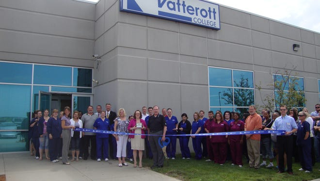 Vatterott College officials and employees celebrate implementation of five new programs with a ribbon-cutting ceremony outside the school's Des Moines location at 7000 Fleur Dr.