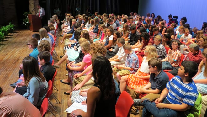 Bataan Intermediate School's fifth grade students and teachers assemble on stage during the annual awards ceremony.