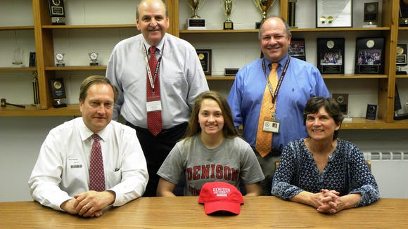 Glen Rock High School senior Bridget Horton is joined by her parents Riley and Patty Horton to celebrate her decision to continue her swimming career at Denison University in Granville, Ohio.  Also on hand to congratulate Bridget are Glen Rock's Director of Athletics Frank Violante (standing, left), and GRHS Principal John Arlotta.  Bridget currently represents the Wyckoff Family YMCA Sharks as one of their national level team members. She has competed at the YMCA National Championships for the past seven years and within the past three years, Bridget has placed in the top 24 in the 200 IM, the 200 Backstroke, and the 200 and 400 Medley relays.