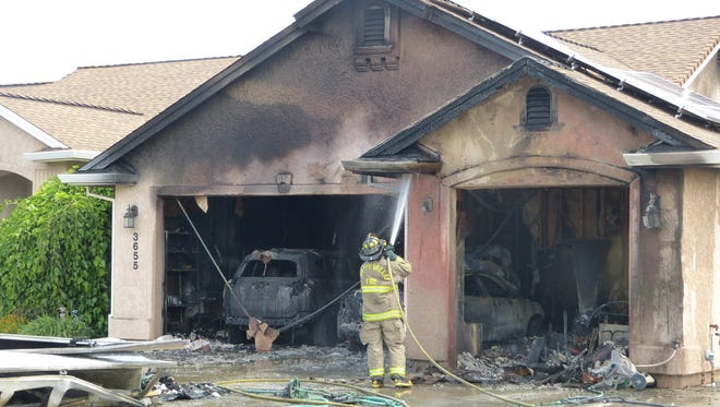 Firefighters extinguished a fire in Cottonwood that erupted in a home garage.