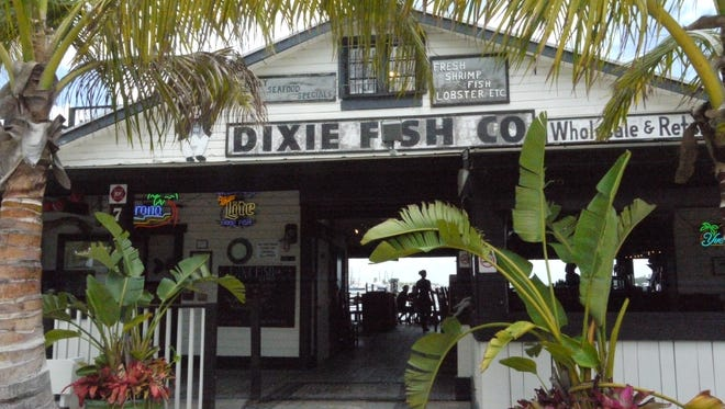 The Dixie Fish Co. is a restaurant that occupies an open-air, 80-year-old former fish market on the San Carlos Island waterfront at Fort Myers Beach.
