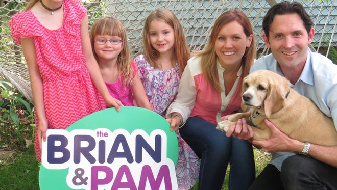 Brian and Pam Wheelock with their children Jillian, Molly, and Katelyn, with their dog, Willow.