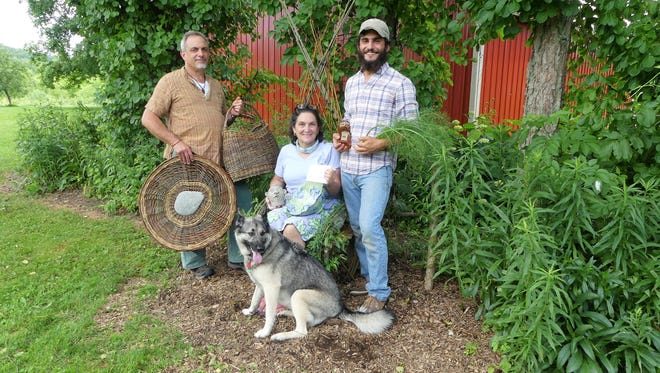 Howard Peller, Maddy Fraioli and Eli Peller with Willow the dog and some of their wares from Rosehill Farm.