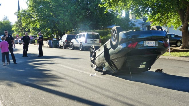 The driver of this car that rolled over Friday on Wilson Avenue near Shasta View Drive in Redding suffered minor injuries, police said