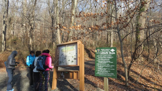 Hikers consult a trail map at the Locust Grove trailhead in South Mountain Reservation.