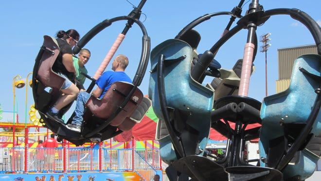 Fairgoers enjoy the rides at Montana State Fair. This year's fair runs July 27-Aug. 4.