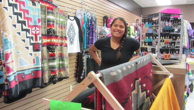 Alicia Parsons, owner of Apache Designs by Dashwoot, opened her store three months ago in the Holiday Village Mall.