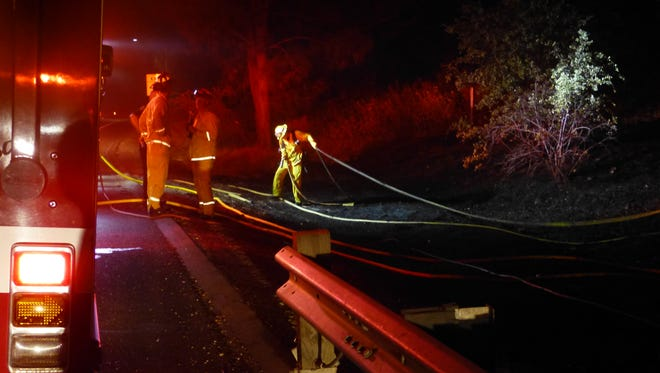 Firefighters responded to a late night fire along Interstate 5 on Friday.