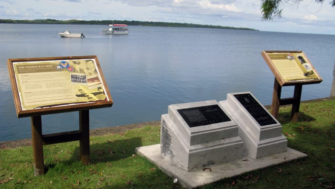 A waterfront memorial on Yap honors the crew of a downed warplane.