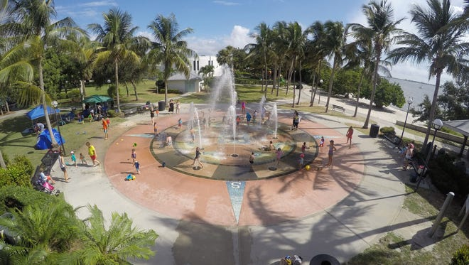 Families play at Indian RiverSide Park's interactive fountain July 12, 2017 in Jensen Beach.