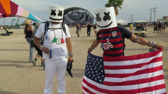 Saul Madrid, left and Ricardo Gonzalez dressed as Sun City Music Festival headliner Marshmello on Saturday at Ascarate Park.