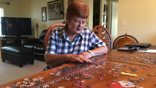 """Melva Culver, 69, seen Sept. 14, 2017 in her Fort Pierce home, was diagnosed with multiple sclerosis in 2010. Recently, she registered with the state to receive medical marijuana as an alternative to the opioid painkillers she has been using. Her illness causes her """"bone pain,"""" frequent loss of balance, and she is unable to perform daily functions such as opening screw-top bottles and jars."""