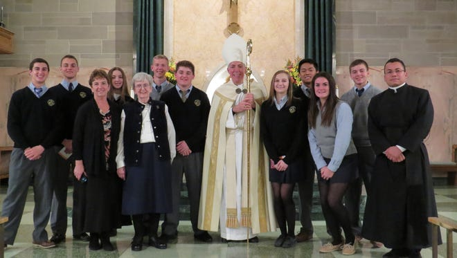 Bishop James F. Checchio poses with representatives of Immacualta High School, Somerville, who attended the Nov. 19 Evening Prayer: In Solidarity with the Poor, the Diocese of Metuchen's local observance of the first World Day of the Poor as proclaimed by Pope Francis.