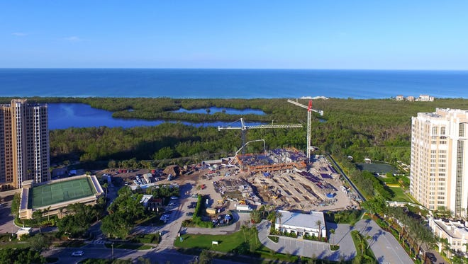 The first residential floor has been poured for Mystique, a 20-story tower in Pelican Bay.