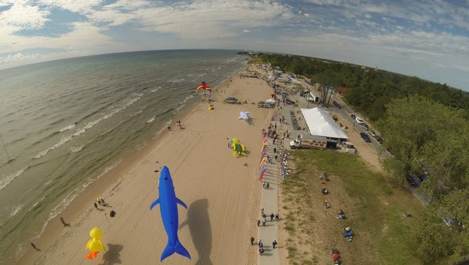 A photo of Kites Over Lake Michigan in Two Rivers features a giant shark kite appearing to swim over the sand. This photo was named a winner in the Manitowoc Area Visitor & Convention Bureau's 2017 Digital Photo Contest.