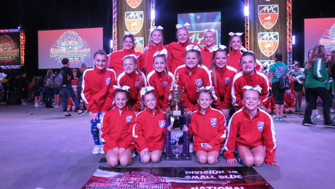 Two Hunterdon Huskies cheer teams returned from Orlando, Florida, with one a national champion and one a nationalrunner-up. In early December, Hunterdon Huskies D12 Pee Wees (pictured), for ages 12 and under, and Hunterdon Huskies D14 Junior Midgets, for ages 14 and under, competed in the 2017 American Youth Cheer (AYC) National Cheer Championships.