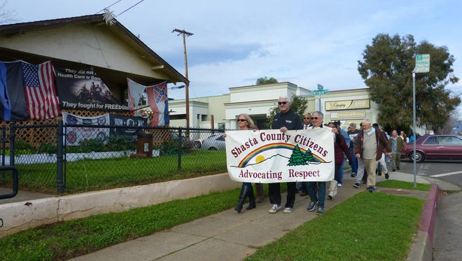 People march from a prayer circle at the Shasta County Courthouse to the MLK Center in Redding on Monday.