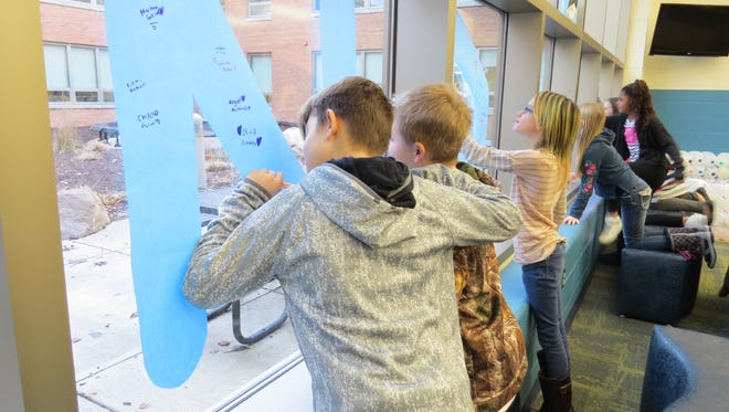Bataan Memorial Intermediate students sign the Kindness pledge banner as part of the Great Kindness Challenge.