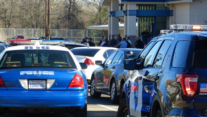 Law enforcement officers investigate an officer-involved shooting near Buckeye school.