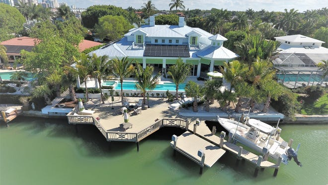 Gulfshore Homes has completed this custom home in The Moorings neighborhood.