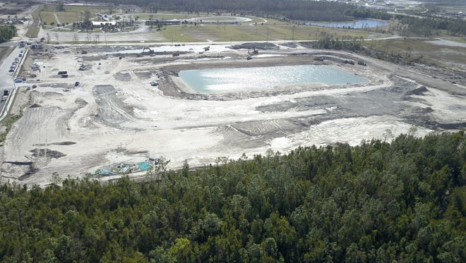 An aerial photograph shows site work in progress for Sapphire Cove, a new residential community being developed by an affiliate of FL Star off Collier Boulevard.