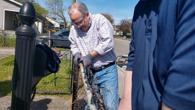 Mayor David Briley works on a fence outside Ronald Williams home during the annual Comcast Cares Day on April 21, 2018.in Nashville, Tennessee